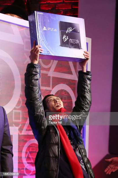 24yearold Joey Chiu of Brooklyn accepts the first Playstation 4 sold in America at the PlayStation 4 North American Official Launch event presented...