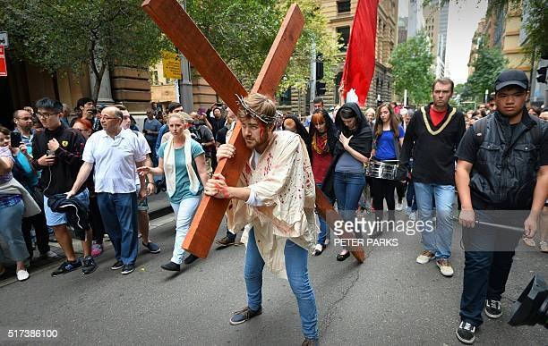 24yearold student Brendan Paul depicting himself as Jesus Christ carries a cross in a reenactment from the bible on Good Friday in Sydney on March 25...