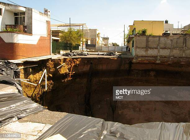 Foot deep sinkhole opened up May 31 at an intersection in Guatemala City after heavy rains. The sinkhole is among a series of disasters -- both...