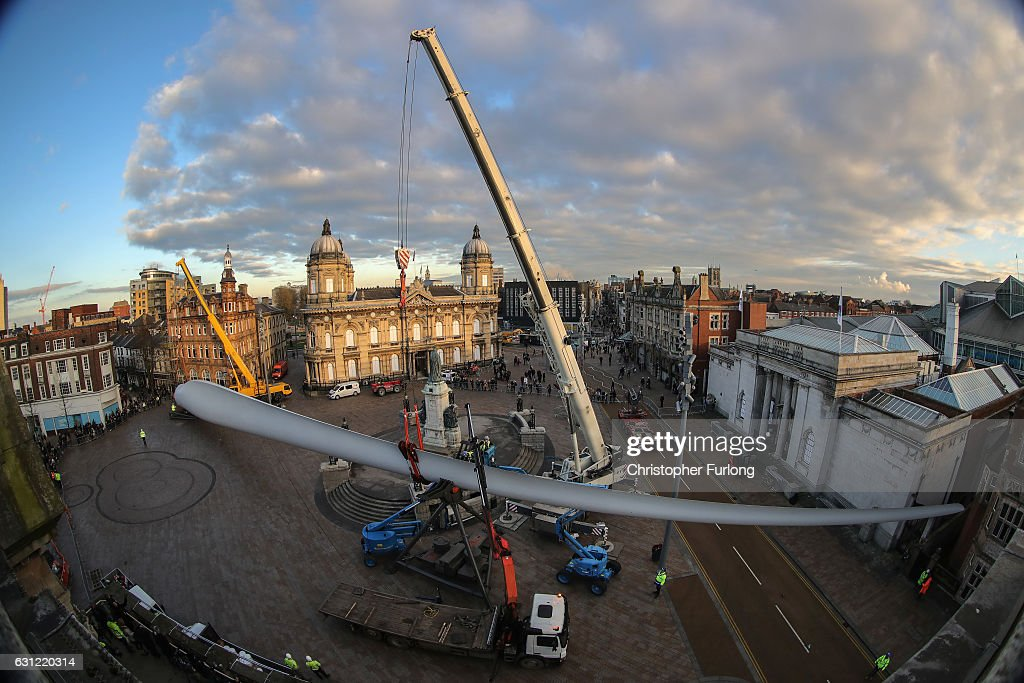 A 250ft-long (75m) wind turbine blade, which forms a new sculpture commissioned by multimedia artist Nayan Kulkarni called 'Blade' is installed at Queen Victoria Square in Hull on January 8, 2017 in Hull, England. The giant wind turbine blade, one of the first made by workers at the new Siemens factory in Hull, will be on show in Queen Victoria Square and is the first in a series of major commissions by different artists that will appear in a variety of locations as part of Look Up, a year-long programme developed as part of Hull UK City of Culture 2017.