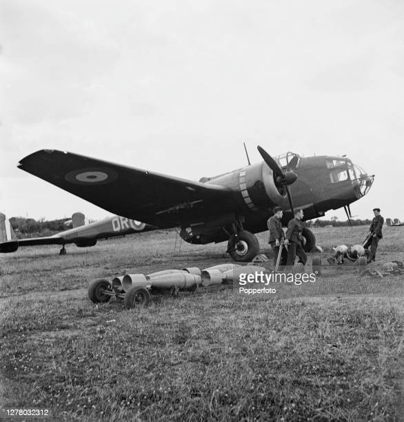 250lb GP bombs on trolleys are prepared by RAF armourers prior to loading into a Royal Air Force Handley Page Hampden Mark I twin engine medium...