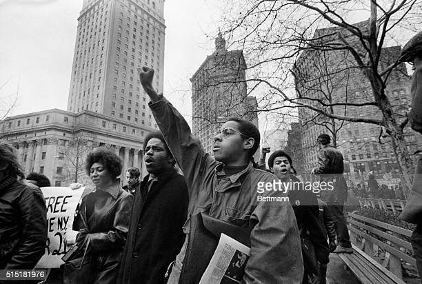 2/5/1970New York NY While one sympathizer gives the Black Panther salute others voice their disapproval of the trial of thirteen Panthers charged...