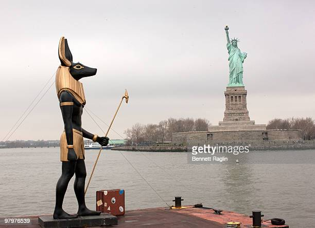 A 25foot Anubis statue rides on a barge to signal the one month countdown to the return of the 'Tutankhamun and the Golden Age of the Pharaohs'...
