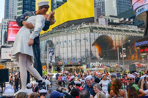 A 25foot tall replica of John Stweart Johnson II's sculpture based on Eisenstaedt's famous photograph towers over the gathering crowd in Times Square...