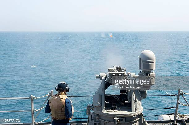 a mk-38 25mm machine gun is fired aboard uss william p. lawrence. - bang boat stock pictures, royalty-free photos & images