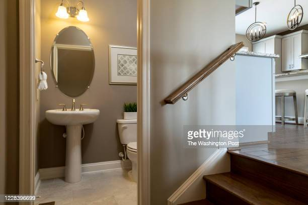 Powder Room in Stairs to Living Level in the Emerson model Home at Potomac Shores on August 25, 2020 in Dumfries Virginia.