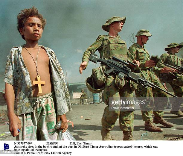 N 357877 009 25Sep99 Dili East Timor As Smoke Rises In The Backround At The Port In DiliEast Timor Australian Troops Patrol The Area Which Was...