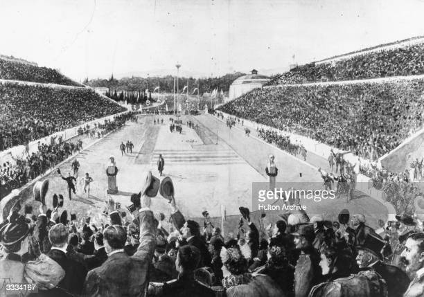 Greek shepherd Spyridon Louis winner of the 40 km marathon is joined by King George I of Greece on the last lap of his run at the Athens Olympics