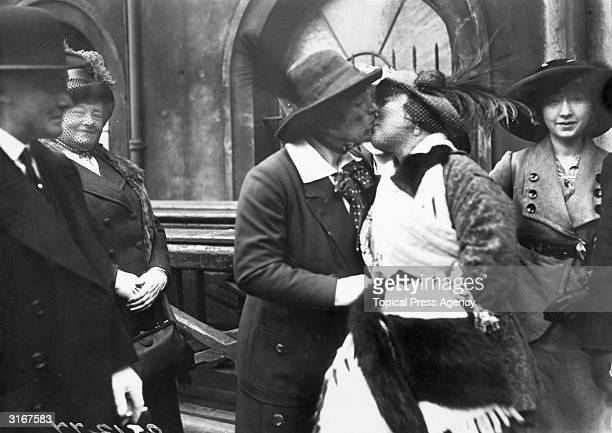 English music hall entertainer Marie Lloyd embraces Claire Roumaine at Paddington Station on Roumaine's return from Australia.