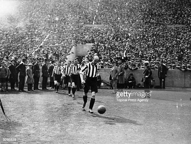 The Sheffield United FC team take the field at Wembley Stadium north London for the FA Cup Final match against Cardiff City Sheffield United went on...