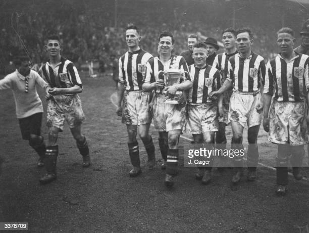 West Bromwich Albion captain Tommy Glidden carries the FA Cup on a vistory lap of honour after his side's 21 victory over Birmingham City 21 in an...
