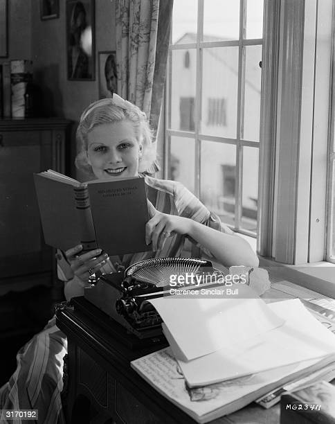 Actress Jean Harlow studies the novel 'Red Headed Woman' witten by Katherine Brush on which the film of the same name was based Harlow took the lead...