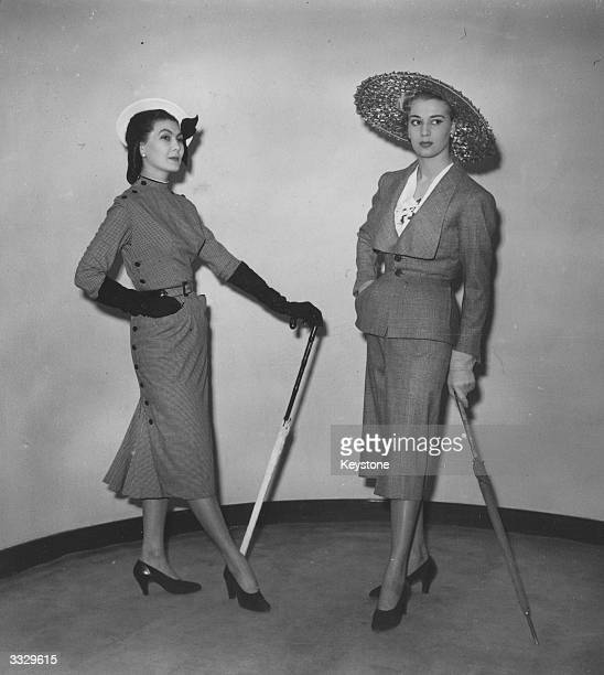 Models at a showing of 90 fashions by French couturier Christian Dior at the Savoy Hotel London On the left is a check suit worn with a large straw...