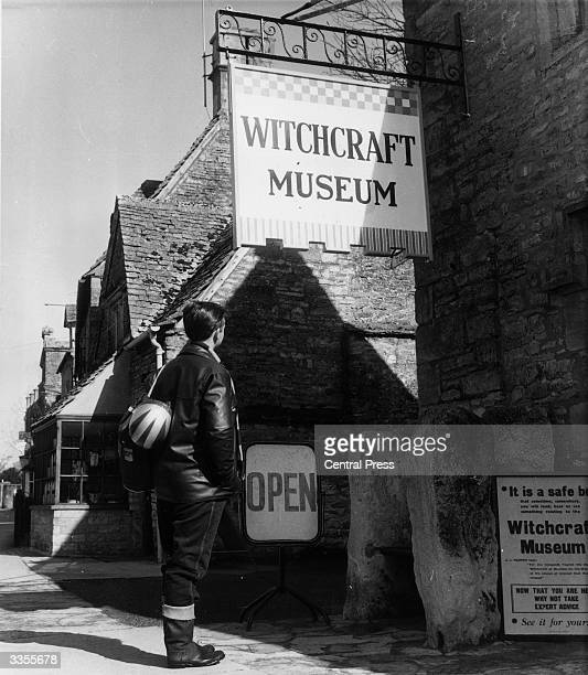 A visitor stands outside the witchcraft museum in BourtonontheWater Gloucestershire The village is increasingly popular with tourists as a typical...
