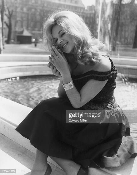 Greek actress Aliki Vouyouklaki enjoys the sun in Grosvenor Square during a visit to London to discuss plans for her first English film.