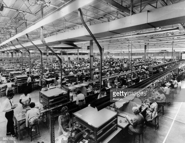A mass production line at the newlyopened Electronics Communications Inc plant at St Petersburg Florida where receivers and transmitters are made to...