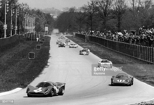 Ferrari P3, which was driven by Nino Vaccarella and Herbert Muller, leading the group at Monza during the Filippo Caracciolo Trophy race - a Sports...
