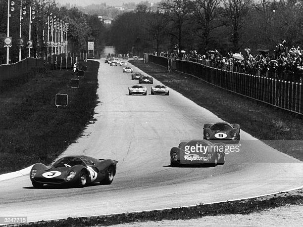 Ferrari P4, which was driven by Lorenzo Bandini and Chris Amon leading the group, along with two other P4's in second and third positions, at Monza...