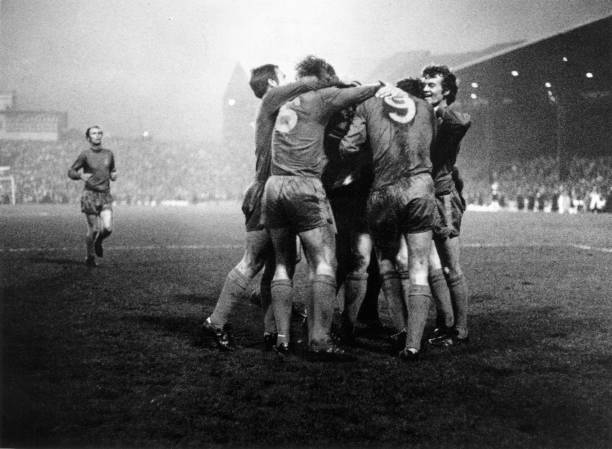 Chelsea players embrace and congratulate Peter Osgood after he scored the equalising goal during the FA Cup final replay against Leeds United at Old...