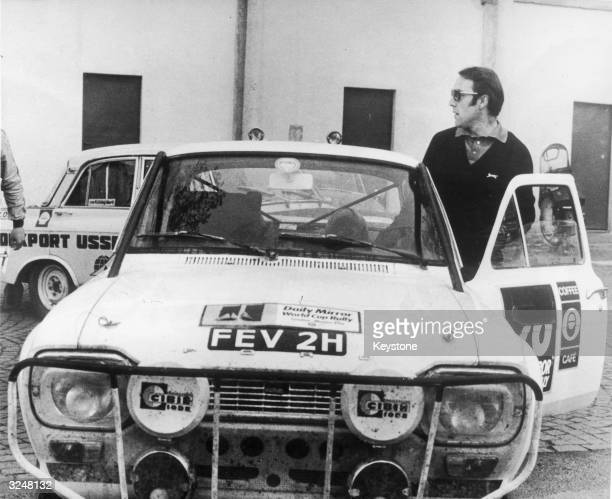 English footballer Jimmy Greaves beside his Ford Escort at the racetrack in Monza during the16,000 mile Daily Mirror World Cup Rally from London to...