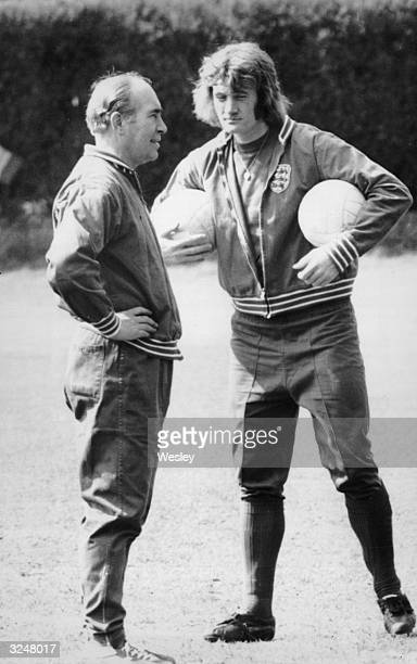 Footballer Rodney Marsh with England manager Sir Alf Ramsey at the Bank of England sports ground in Roehampton during a training session for the...
