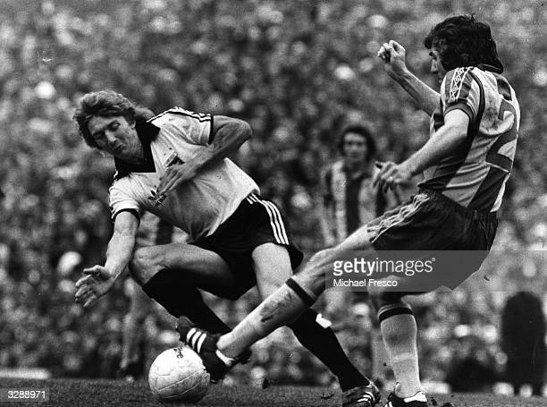 Clive Woods of Ipswich Town clashes with West Bromwich Albion's Paddy Mulligan at Highbury