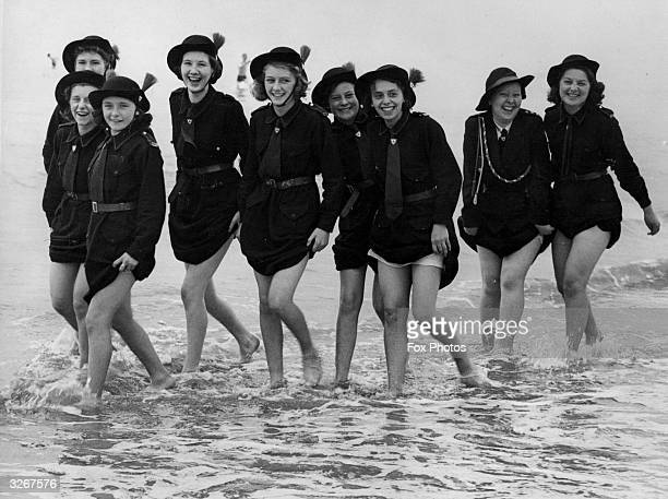 Girls of the 7th Manchester Regiment Church Girls Brigade who are in camp at Bridlington, making the most of their holiday by the sea.