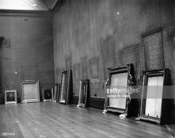 Pictures and empty frames on the floor of the National Gallery, where, like many of the other museums and galleries in London, the treasures are...