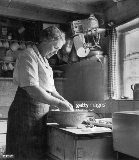 Mrs ChappleRyan one of six female Parish Councillors in Bishop's Itchington making pastry in the kitchen Original Publication Picture Post 5384 Six...