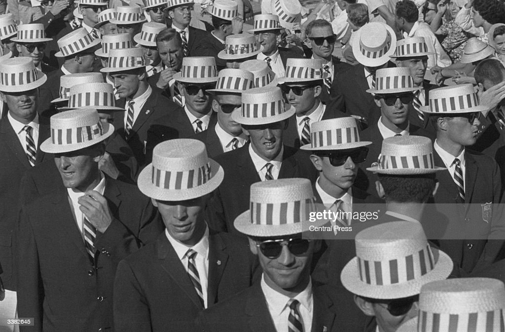 The US team en route to the opening ceremony of the 1960 Rome Olympics, wearing straw hats and sunglasses.