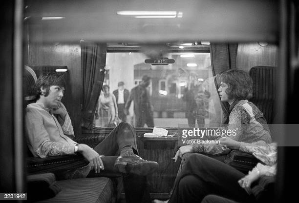 Paul McCartney Of The Beatles And Mick Jagger Rolling Stones Sit Opposite Each Other