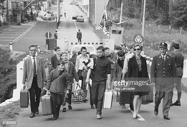 Refugees at the border between Czechoslovakia and Germany after the Soviet invasion following the 'Prague Spring' in which the Czech communists tried...