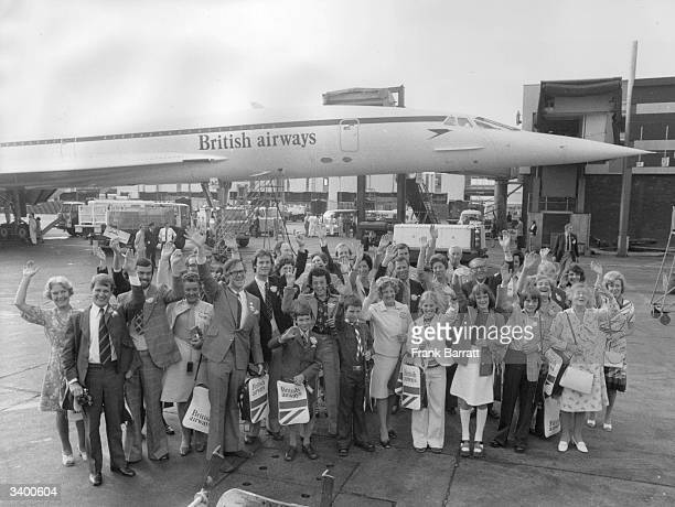 Thirtyfive winners wave goodbye before departing from Heathrow Airport London on Concorde's first public passenger flight