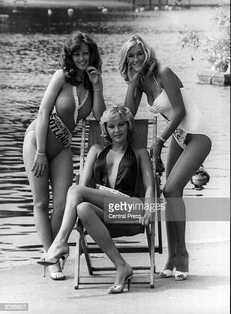 Georgina Kearney of Scotland, Lyn Coombs of Arun, and Nikki Wright of Swanage relax by the Serpentine, Hyde Park, London, during selections for the...