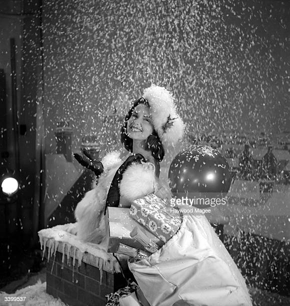 British actress Patricia Plunkett during a christmas photo shoot for ABC films Original Publication Picture Post 4701 How Films Send Greetings pub...