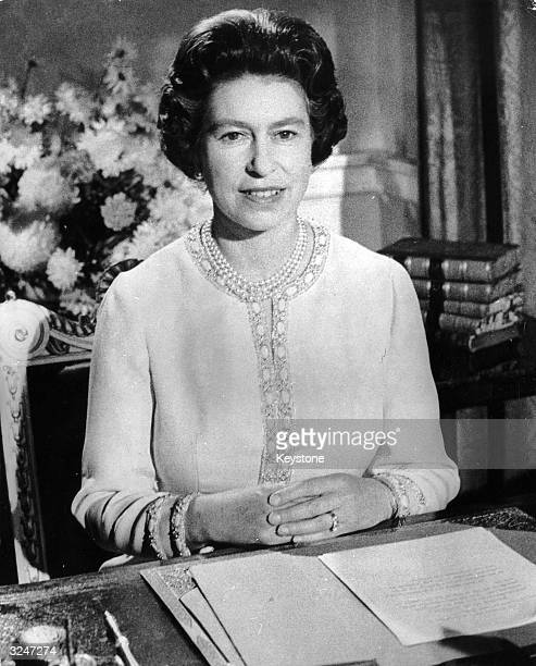 Queen Elizabeth II broadcasting her annual Christmas Day speech from Buckingham Palace.