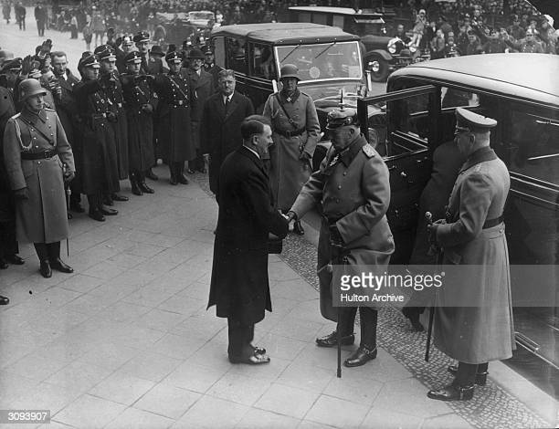German chancellor Adolf Hitler shakes hands with Paul von Beneckendorff und von Hindenburg president of Germany at Berlin on the Day of National...