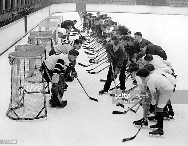 Famous Canadian ice hockey coach Clint Benedict trains young members of the Fleas how to score goals on the ice at Wembley 60 schoolboys between 10...