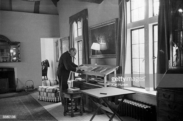 British statesman Winston Churchill at home in the study of his Chartwell estate in Kent Most of his work is done standing up at a desk specially...