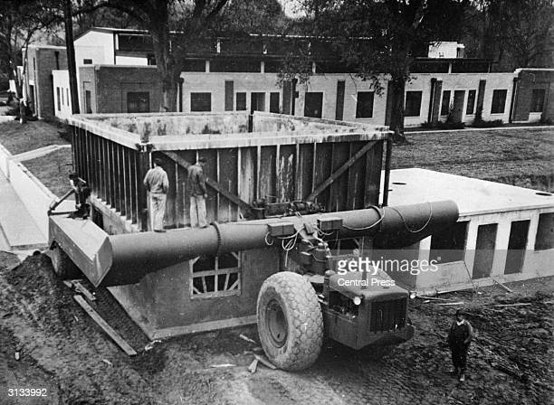 A Tournalayer provides one answer to Britain's acute postwar housing shortage by building a lowcost concrete house in only 24 hours The machine drops...