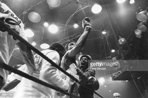 American boxer Cassius Clay later Muhammad Ali celebrates his win over Sonny Liston in their heavyweight title fight at Miami Beach Florida Clay won...