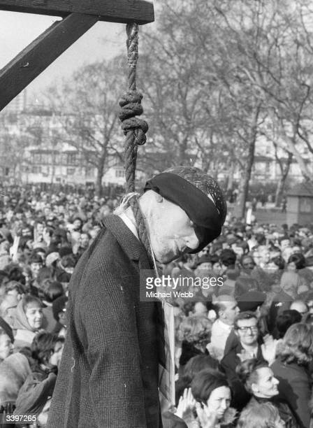 The effigy of a hanging man which was carried to a mass rally of striking postal workers in Hyde Park London