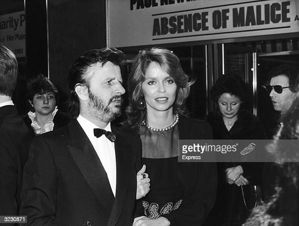 British rock musician Ringo Starr walks arm in arm with his wife actor Barbara Bach at the British premiere of director Sydney Pollack's film...