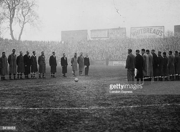 The players of Blackpool and Fulham respectfully observe an unbroken two minutes of silence in memory of the King, before the kick of a 4th round FA...
