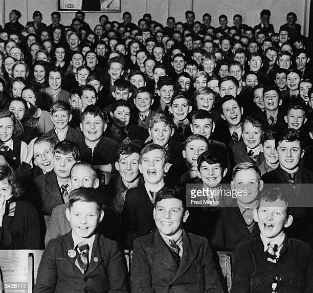 Schoolchildren enjoying a performance by the 'Pilgrim's Players' at Ashford in Kent