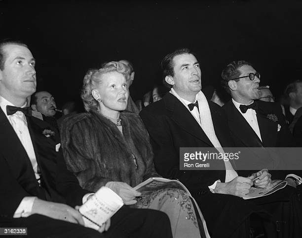 American actor Gregory Peck and his first wife Greta attend a boxing match between Freddie Mills and Joey Maxim at Earl's Court, London.