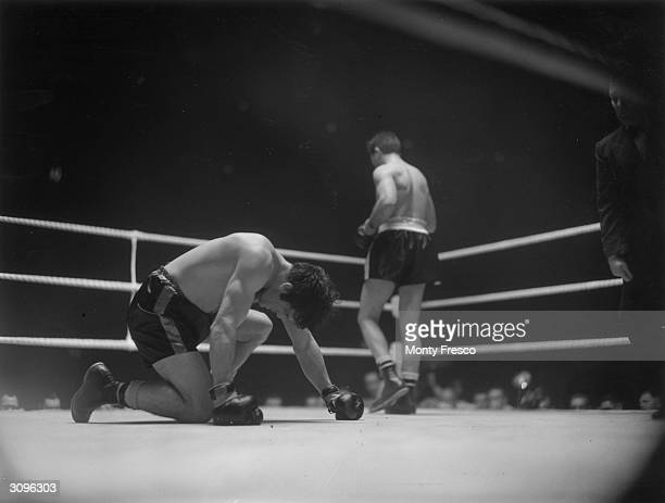 British boxer Freddie Mills loses his world light-heavyweight title to America's Joey Maxim in the tenth round of their fight at Earl's Court, London.