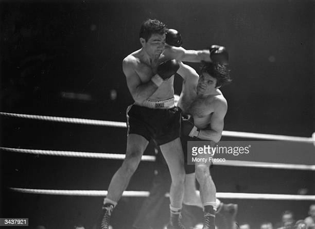 Joe Maxim the American boxer and Heavyweight Champion of the World fighting British boxer Freddie Mills in a title fight at Earl's Court