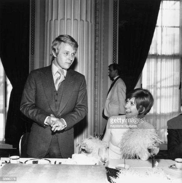Newlywed pop singer Cilla Black listens to her husband manager Bobby Willis giving his speech at their wedding reception held at the Adelphi Hotel,...