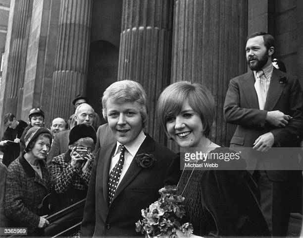 Newlyweds pop singer Cilla Black and her manager Bobby Willis after their wedding ceremony.